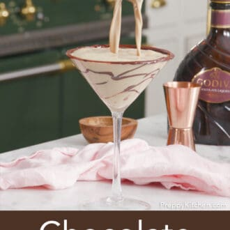 A chocolate martini getting poured into a glass.