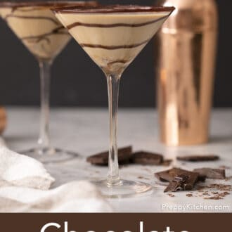 Two chocolate martinis with a swirls of chocolate syrup.