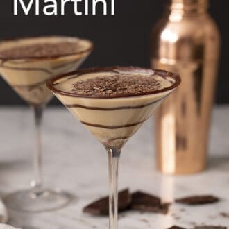Two chocolate martinis in front of a copper shaker.