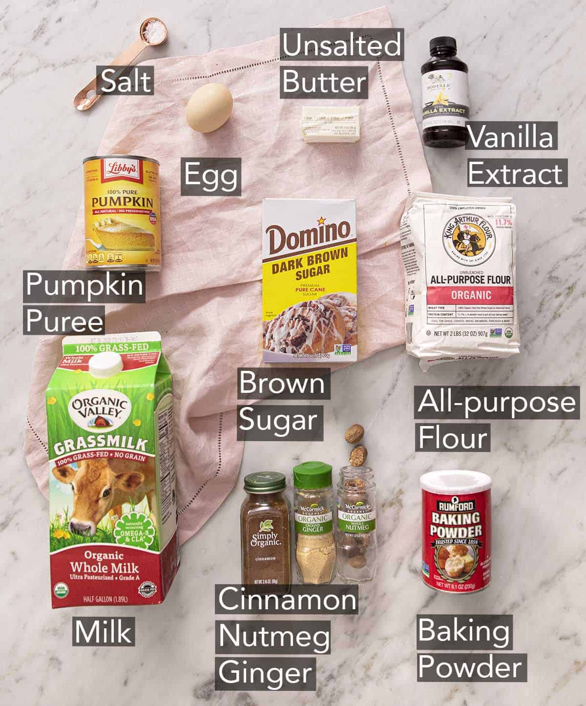 Ingredients to make Pumpkin Pancakes on a marble counter.