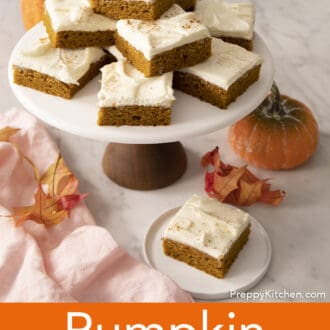 A group of pumpkin bars on a cake stand.