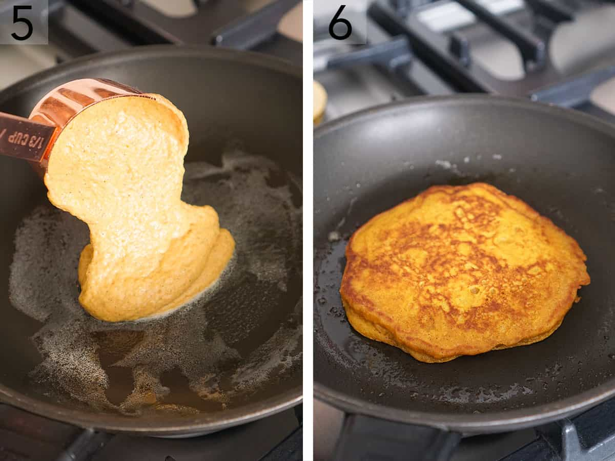 Pumpkin pancakes cooking in a nonstick pan.
