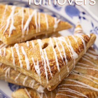 Apple turnovers on a blue and white serving plate.