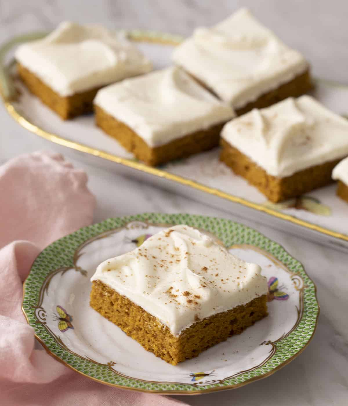 Pumpkin bars on a porcelain serving tray.