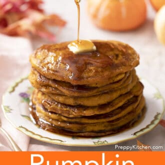 Maple syrup pouring on a stack of pumpkin pancakes.