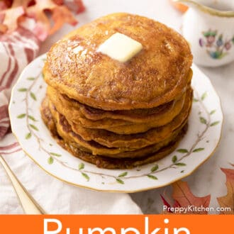 A big stack of pumpkin pancakes with butter and syrup.