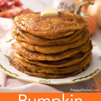 Pumpkin pancakes wiht butter and syrup on a plate.