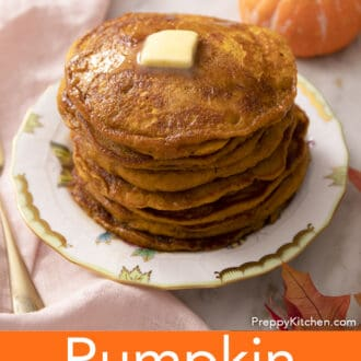 A stack of many pumpkin pancakes on a white plate.