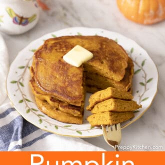 A golden fork with pieces of pumpkin pancakes on it.