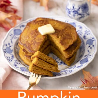 A fork with three pieces of pumpkin pancakes on it.