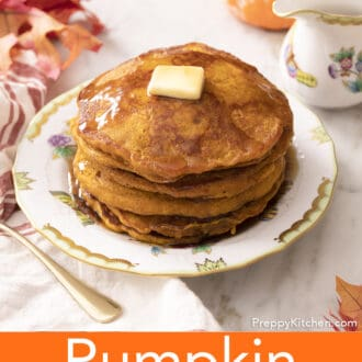 A stack of pumpkin pancakes on a porcelain plate.