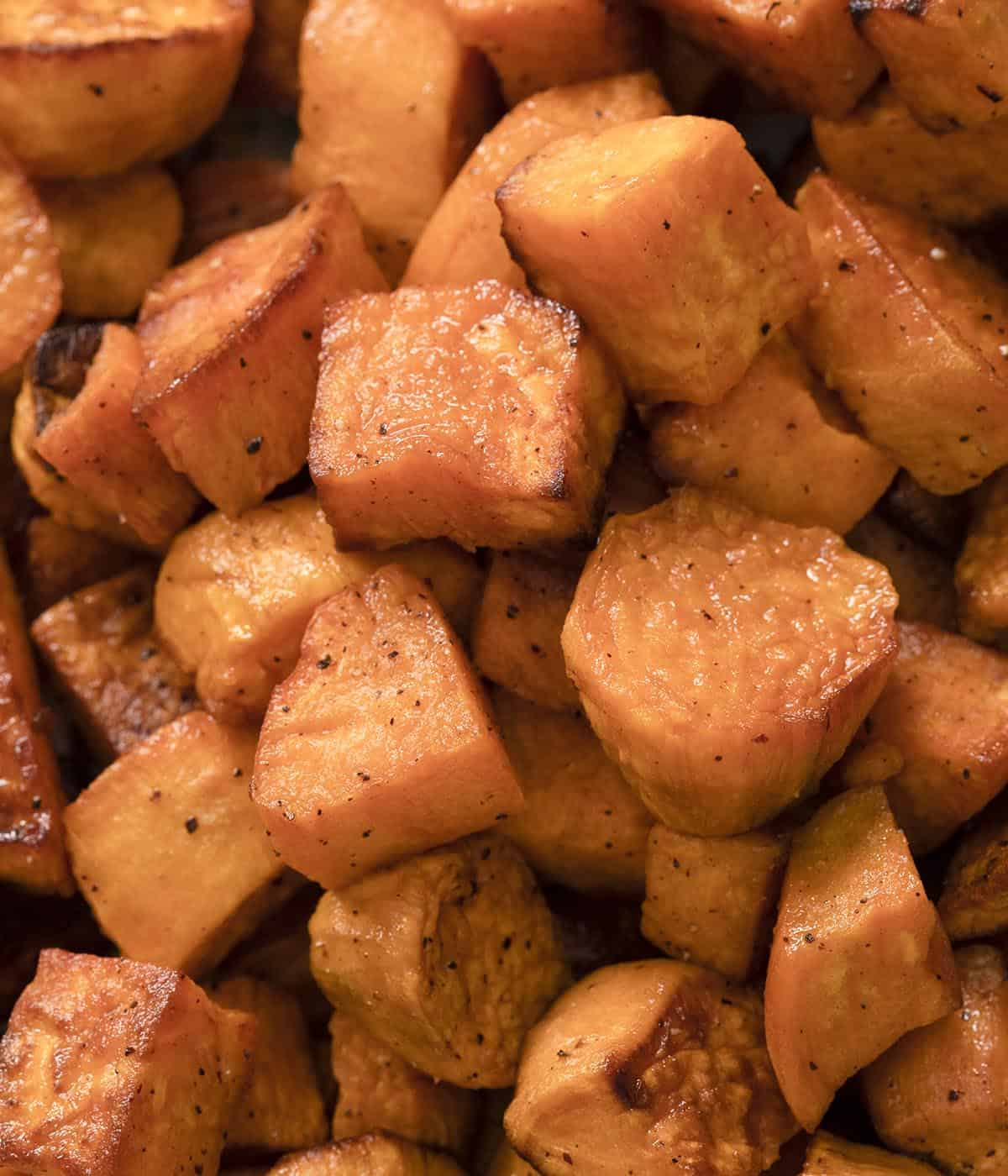 A close up photo of a group of roasted sweet potatoes.