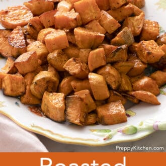 Roasted sweet potatoes on a floral platter