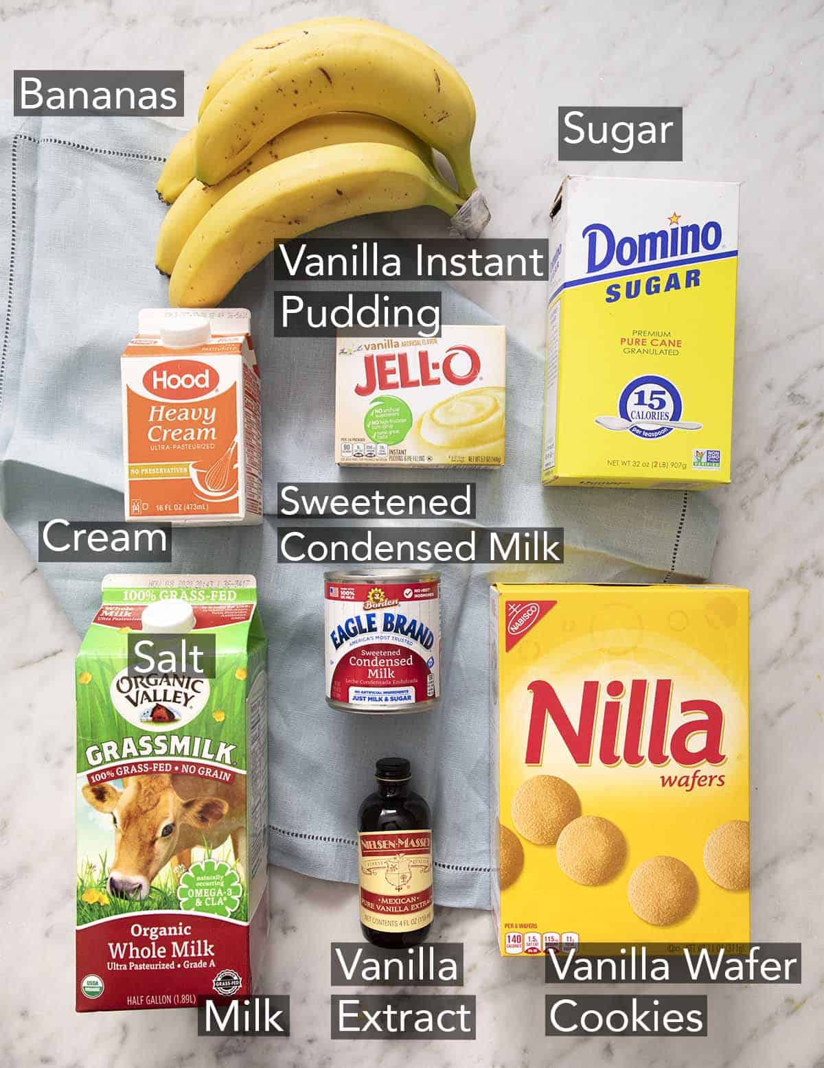 Ingredients for banana pudding on a marble counter.
