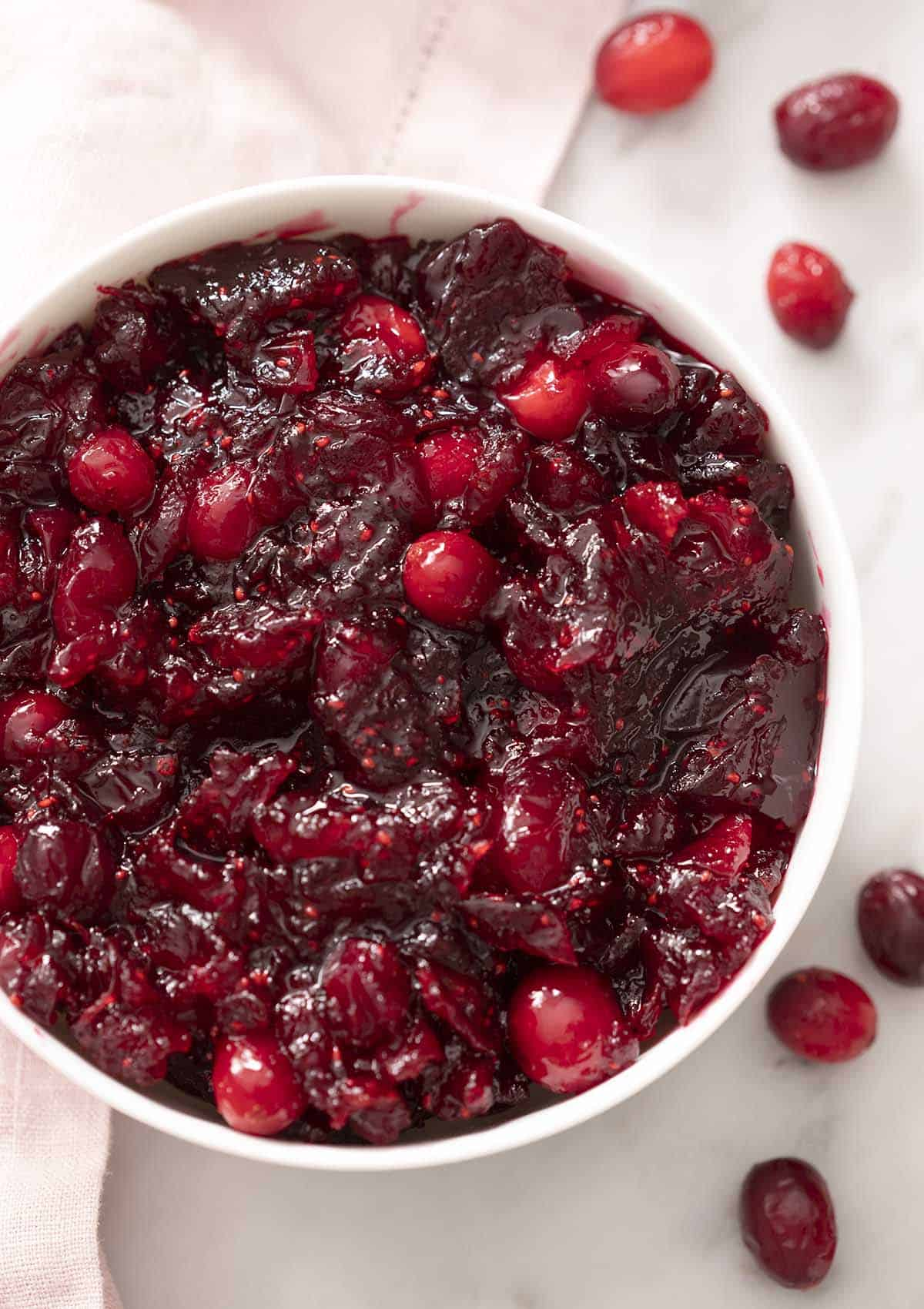 A white bowl filled with homemade cranberry sauce.