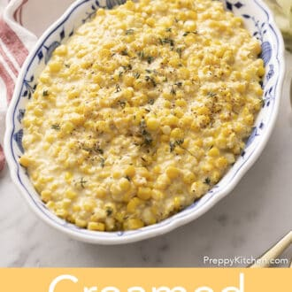 Creamed corn in a blue and white serving dish.