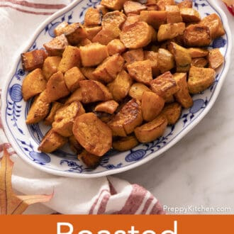 Roasted sweet potatoes on a blue and white platter