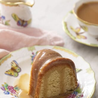 Piece of rum cake sitting on a floral plate