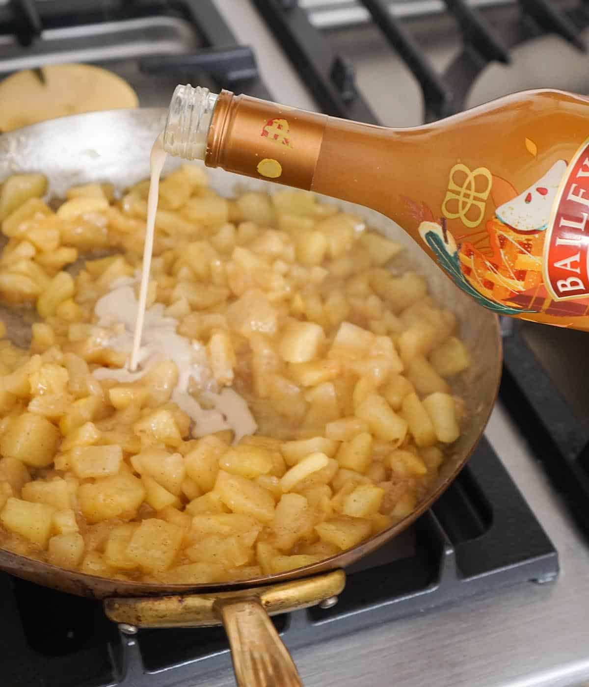 Baileys getting poured into apple pie filling.