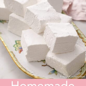 several cubed marshmallows on a floral platter with a pink napkin