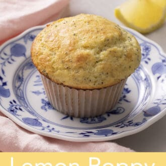 a lemon poppy seed muffin on a blue and white plate