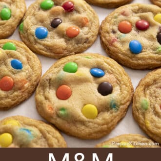 several M&M Cookies on a counter in a grid configuration