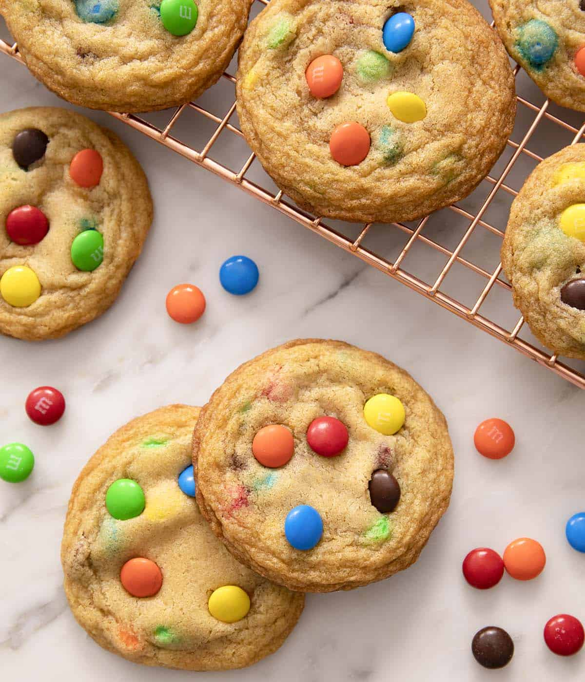 M&M cookies on a marble counter.