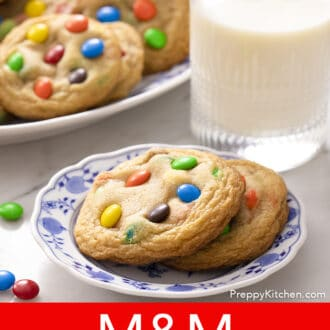 2 M&M Cookies on a blue and white plate