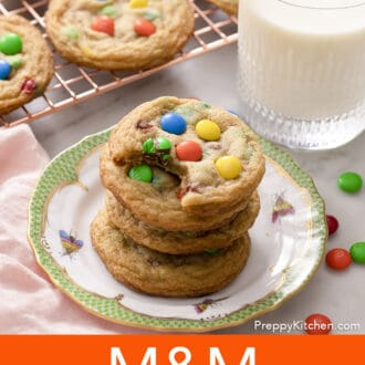 a stack of M&M Cookies on a plate with a green border