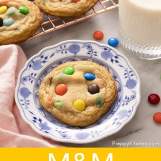 an M&M Cookie on a blue and white plate