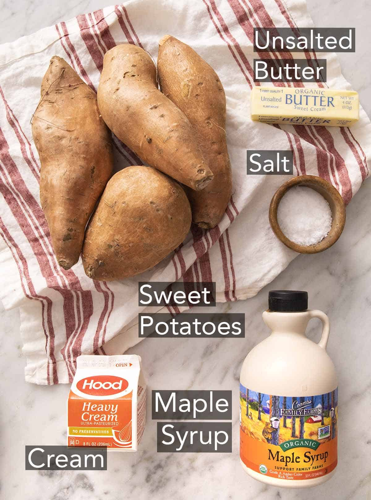 Ingredients to make mashed sweet potatoes on a marble counter.