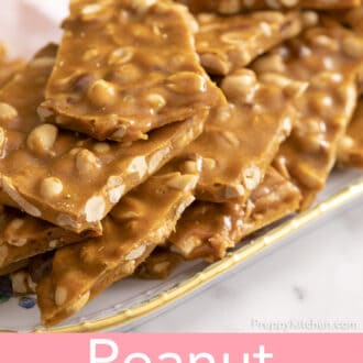close up of pieces of peanut brittle stacked on a floral plate