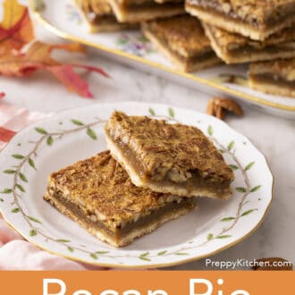 pecan pie bars stacked on a plate