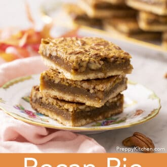 3 pecan pie bars stacked on a plate