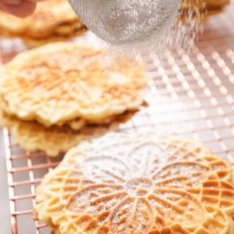 A pinterest graphic of Pizzelle cookies