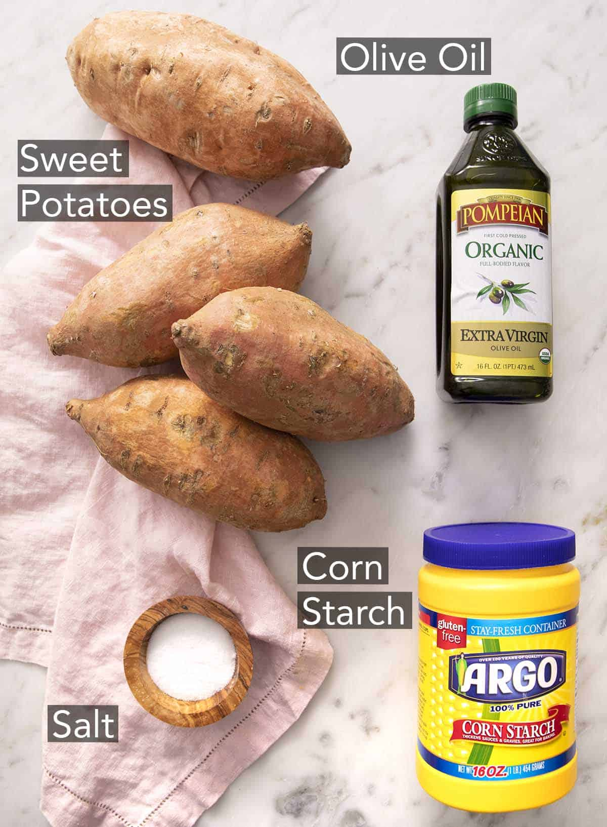 Ingredients for making sweet potato fries on a counter.