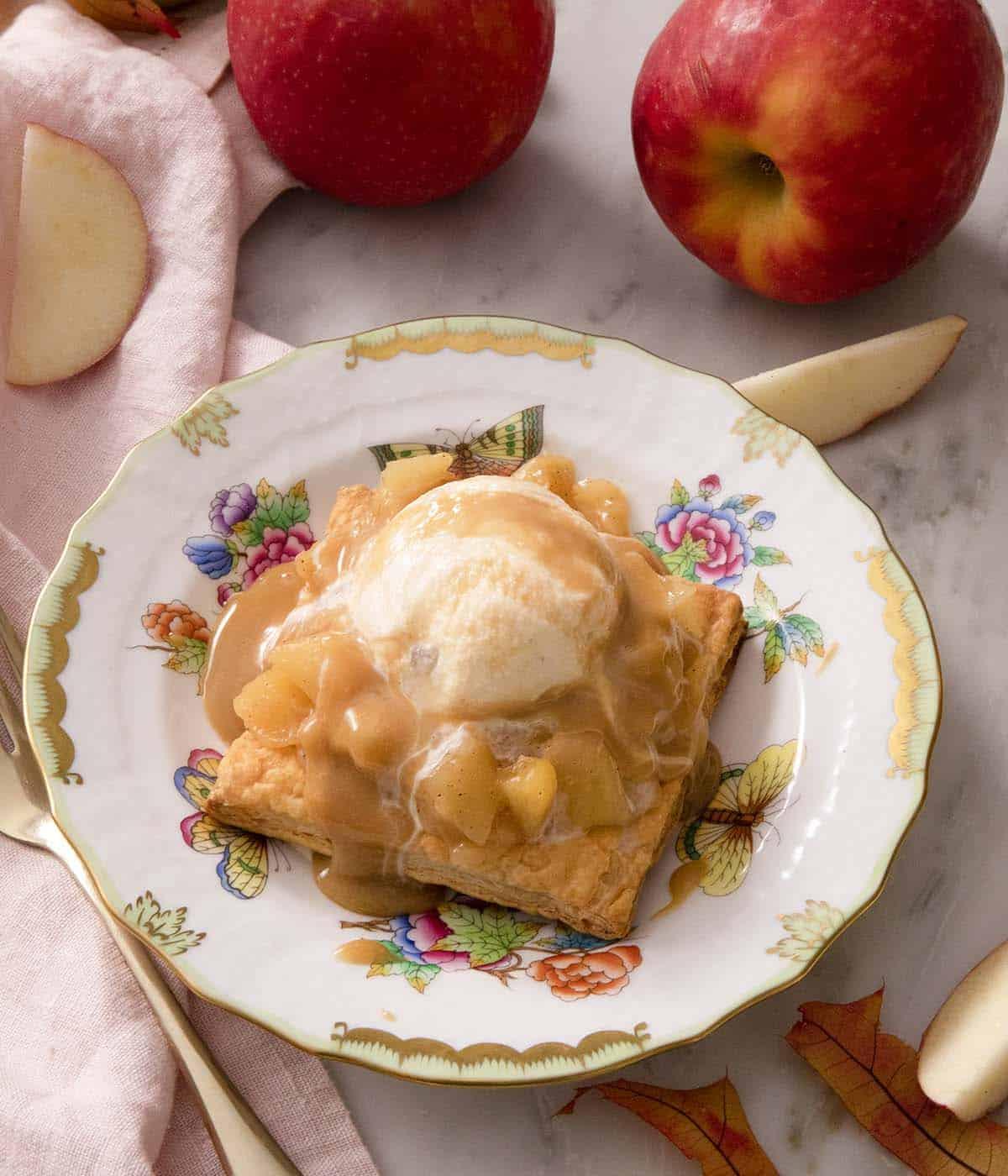 Icre cream melting on a apple tart.