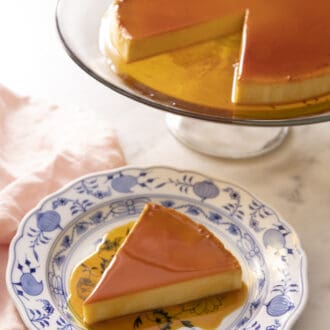 Piece of flan on a blue and white plate