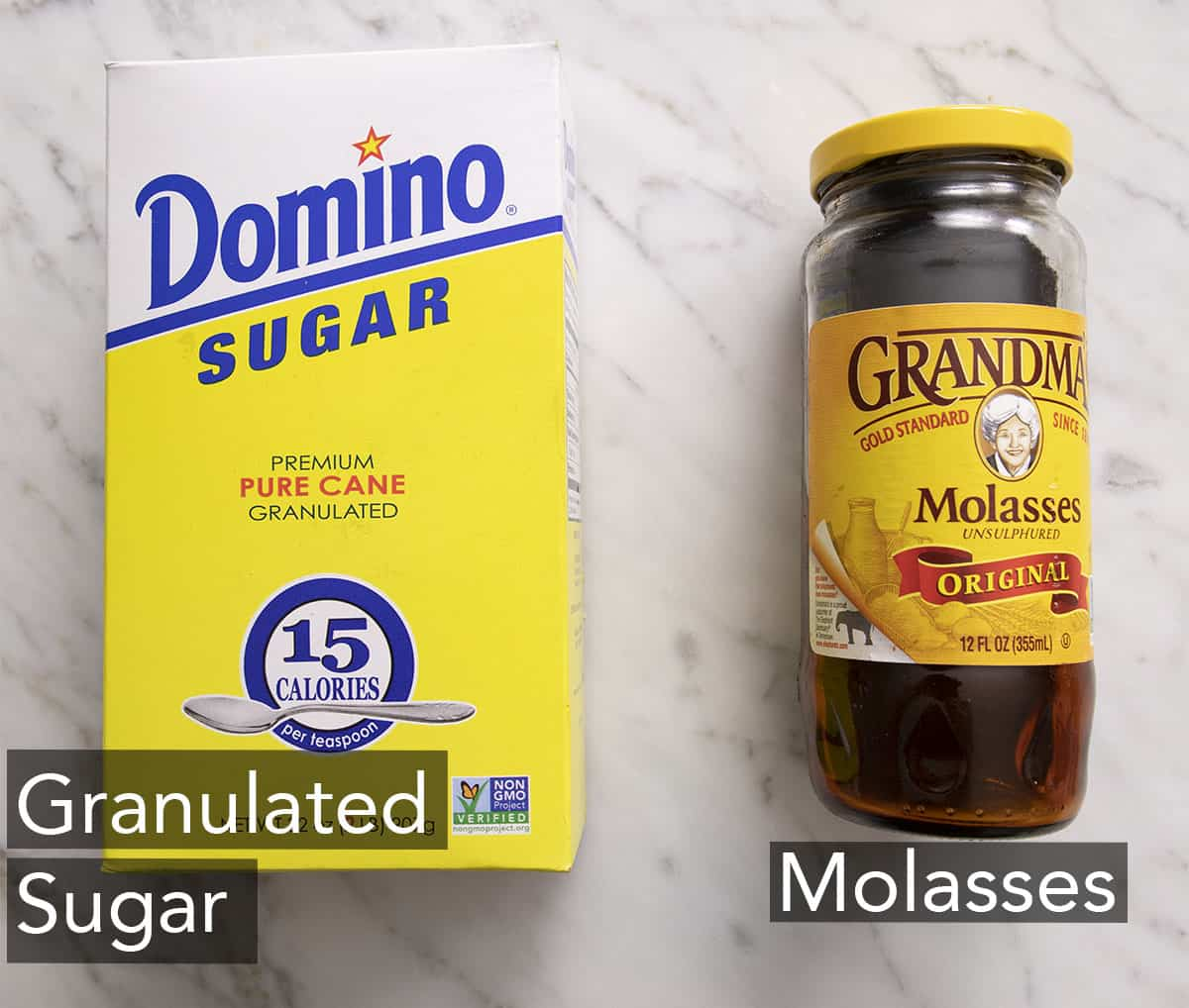 The two ingredients needed to make brown sugar on a marble counter.