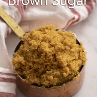 brown sugar in a copper measuring cup