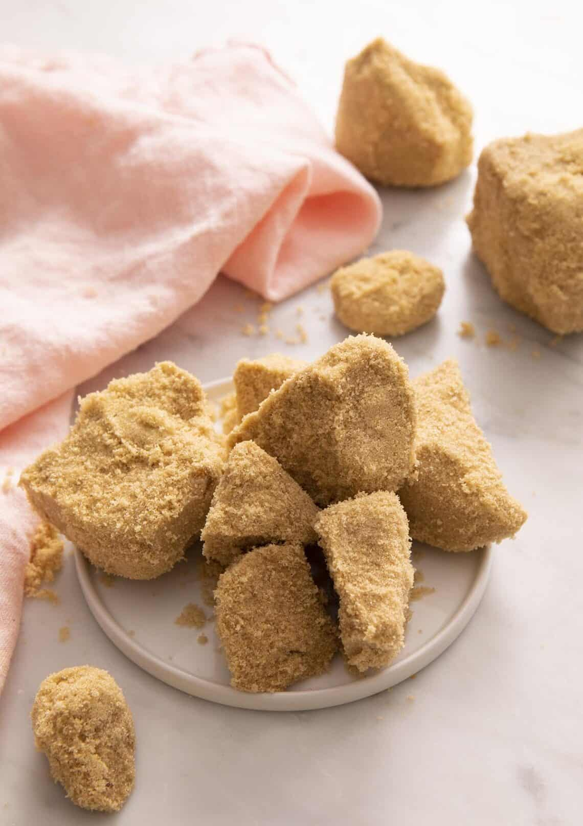 Hardened brown sugar clumps on a marble counter.