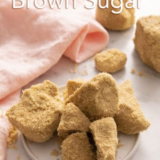 chunks of hardened brown sugar on a white plate.