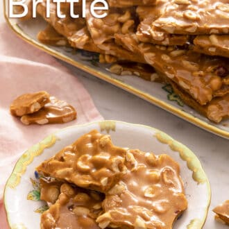 pieces of peanut brittle stacked on a floral plate