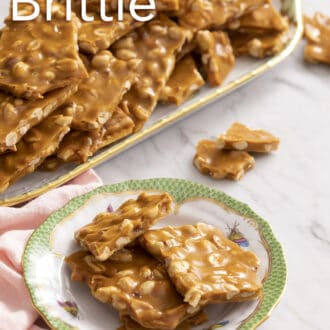 pieces of peanut brittle stacked on a porcelain plate