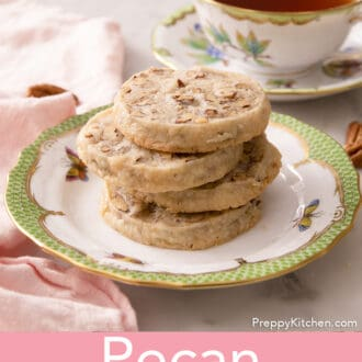 several pecan sandies stacked on a plate