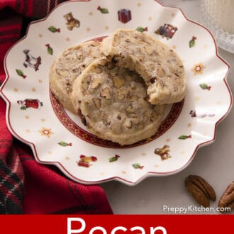 pecan sandies stacked on a christmas plate
