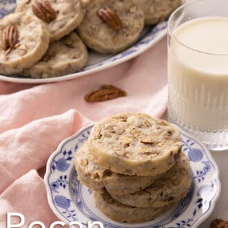 pecan sandies stacked on a blue and white plate