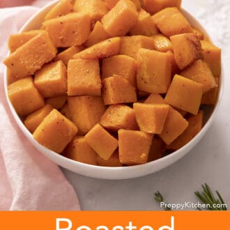 cubed roasted butternut squash in a white bowl