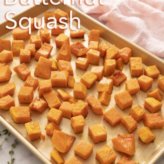 cubed roasted butternut squash spread across a baking sheet