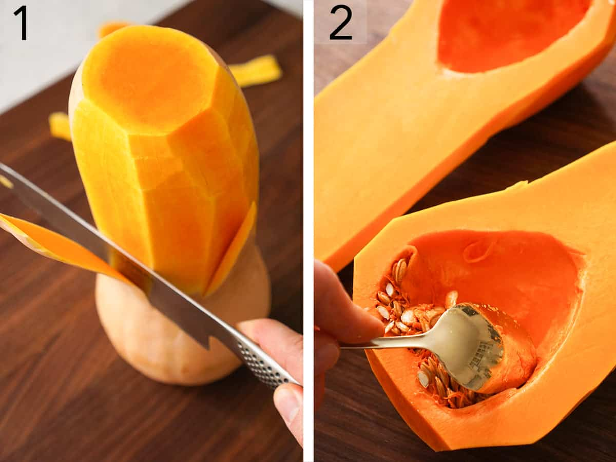 A halved butternut squash having it's seeds removed with a spoon.